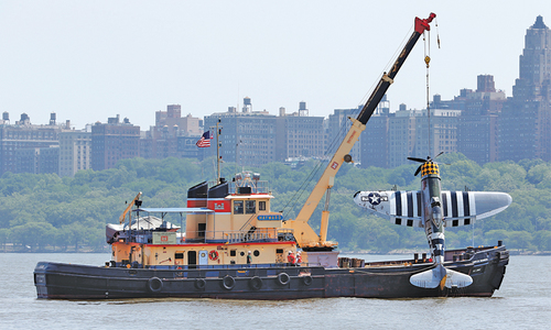 WWII-era plane crashes in Hudson River; body recovered