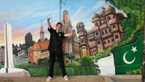 Meet Sebastian Schmidt, the German graffiti artist who just painted a Welcome mural for Karachi's visitors