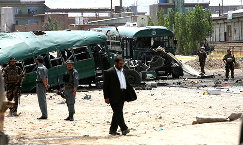 At least 27 killed in Kabul as two bombs hit convoy of Afghan police cadets