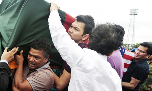 A coffin bearing the body of a victim of the attack on the Holey Artisan Bakery, draped in the Bangladesh and US flags is brought in for a ceremony for people to pay their tribute at a stadium in Dhaka on Monday, July 4, 2016. —AP