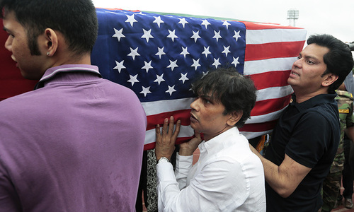 Relatives of Abinta Kabir, student of Emory University in the US, carry her coffin draped with the Bangladesh and US flags after a ceremony for victims of the attack.  —AP