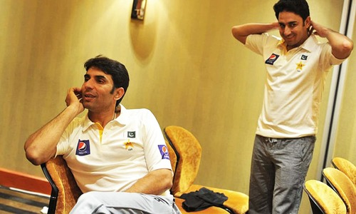 Best friends: With the (now out-of-form and discarded) Saeed Ajmal.