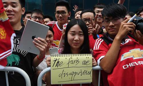 Manchester derby in Beijing called off after bad weather