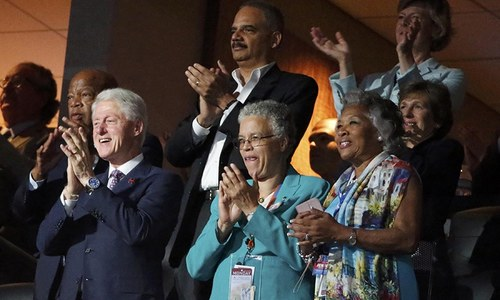 Former President Bill Clinton applauds First Lady Michelle Obama's speech at the Democratic National Convention in Philadelphia, Pennsylvania, U.S. July 25. — Reuters