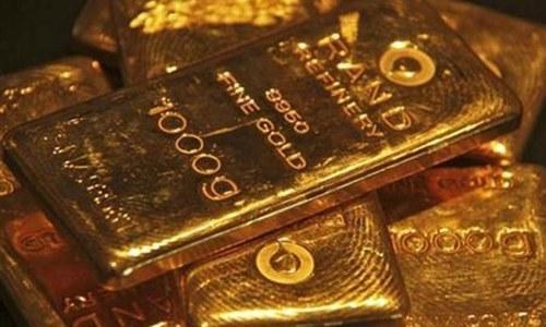 Gold rises as dollar retreats