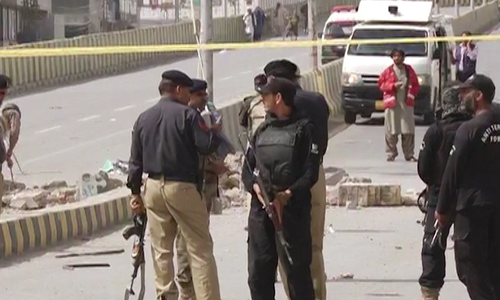 Police and rescue officials at the scene of the blast on Zarghon Road. ─DawnNews screengrab