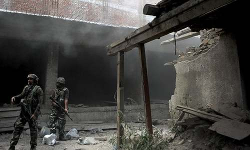 Indian army soldiers take position inside a building after a gunfight in Srinagar on August 15, 2016. — AFP