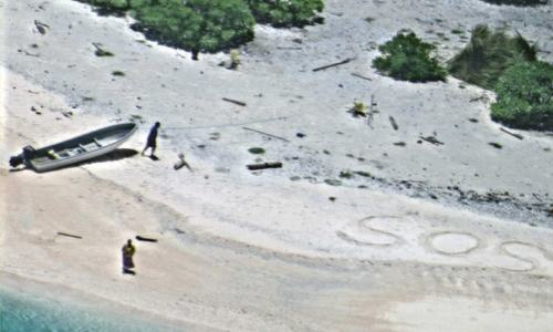 'SOS' in sand leads to rescue of two people stranded on island