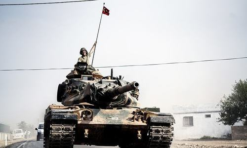 Turkish tanks roll into Syria, opening new line of attack