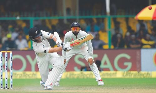 Williamson, Latham stay rock-solid  on rain-marred day