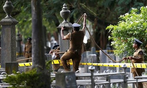 Lankan police exhume journalist's body in murder he predicted