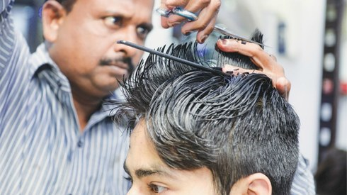 From Karachi to Lahore, how do men prefer to wear their hair?