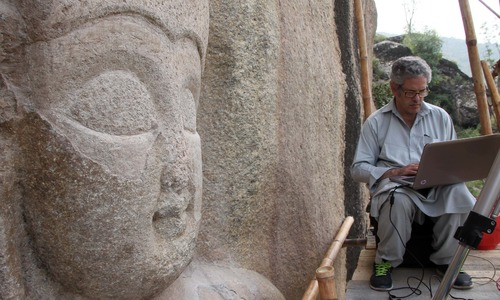 Iconic Buddha in Swat valley restored after nine years when Taliban defaced it