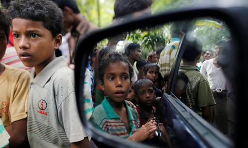 Hundreds of Rohingya flee Myanmar army crackdown to Bangladesh