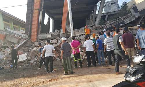 97 dead, scores injured in Indonesian quake
