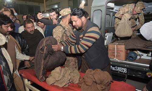 Soldiers transport remains found in the wreckage of the crashed PIA passenger plane Flight PK-661 to a mortuary at a hospital in Abbottabad, December 7, 2016. — AFP.