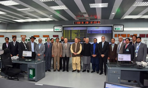 Nawaz Sharif along with Khawaja Asif and Sartaj Aziz pose for photographs after the inaugural ceremony of Chashma-III reactor. —AFP