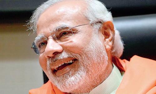Modi replaces Gandhi as face of India's homespun cotton, raises furore