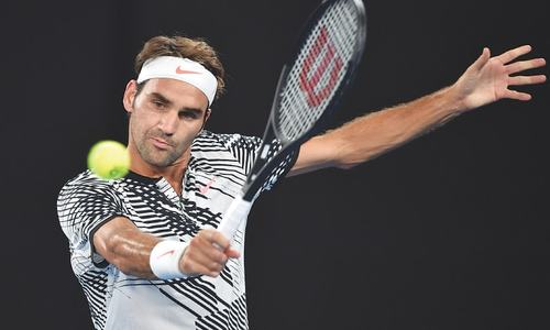Federer returns with win to join Murray in second round