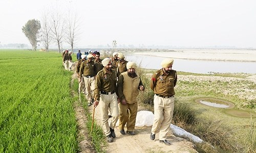 Indian police take part in a search to recover equipment used to make raw alcohol during a search at Dhole Wal village in Dharamkot, some 80kms from Jalandhar.  — AFP