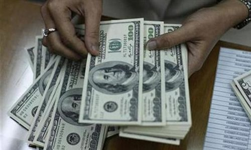 Dollar gains against rupee