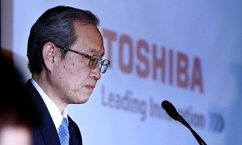 Toshiba files results unapproved by auditor; warns 'its survival in doubt'