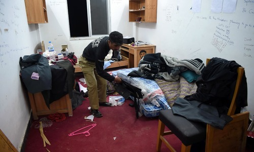 Policeman inspect a room of Mashal Khan. —AFP