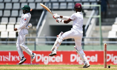 3rd Test: Chase and Holder dig in to defy Pakistan