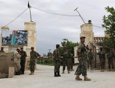 Militant attack on Afghan army base kills 10 soldiers