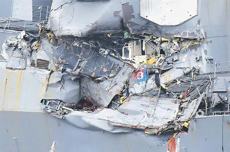 US destroyer in narrow escape after collision; bodies found