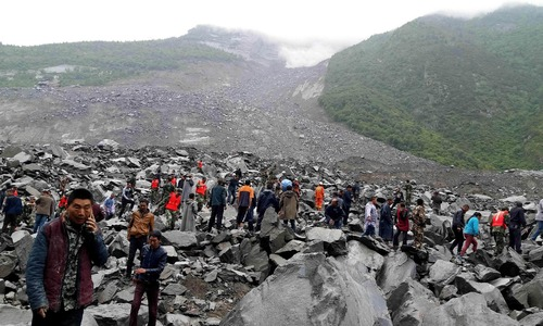 Five dead, 120 missing in China landslide