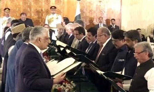 Cabinet members take oath at the ceremony in the Presidency.— DawnNews