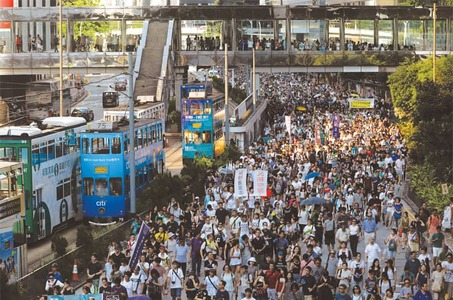Tens of thousands protest in HK over jailing of democracy activists