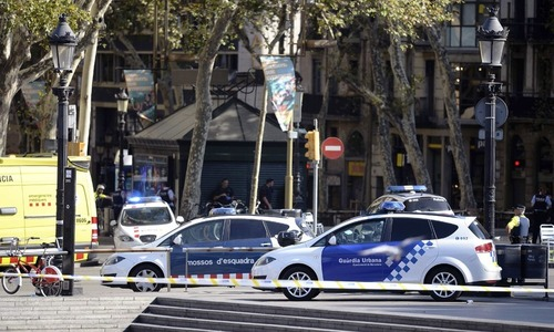 Spain identifies driver of Barcelona rampage van as hunt continues