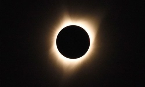 In pictures: moon blots sun out of the sky in historic eclipse