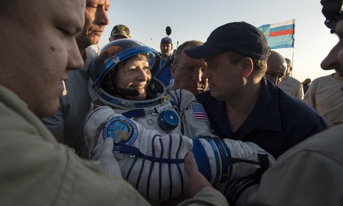 Peggy Whitson is helped out of the Soyuz MS-04 spacecraft just minutes after, along with Roscosmos cosmonaut Fyodor Yurchikhin and NASA astronaut Jack Fischer landed in a remote area near the town of Zhezkazgan, Kazakhstan — AFP
