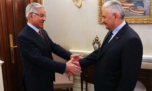 Turkish prime minister greets Asif before their meeting. —Photo courtesy FO