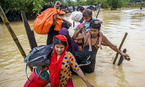 Rohingya Muslims move camp to camp amid rain, mud slides and extortion
