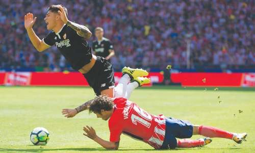 Costa watches Griezmann fire Atletico into second spot