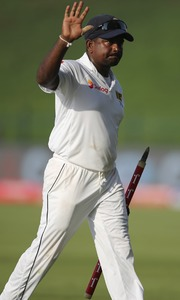 Rangana Herath waves after they beat Pakistan during their fifth day at First Test cricket match in Abu Dhabi, United Arab Emirates, Monday, Oct. 2, 2017. —AP