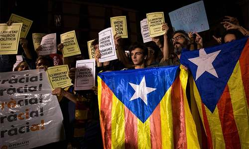 Senior separatists detained as Madrid piles pressure on Catalonia