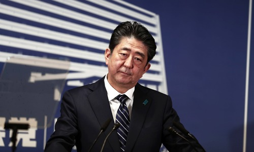 Japan's Abe targets North Korea after storming to 'super-majority' vote win