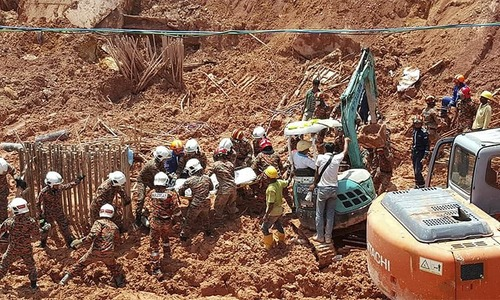 Mostly foreigners among 11 killed in Malaysian landslide as toll rises