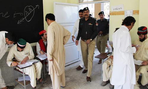 Police officials visit polling station as polling agents cater to voters. —Photo by Sirajuddin