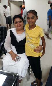 Hina, 10, poses with an official in India. —Photo courtesy Indian High Commission