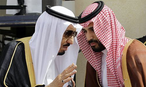 King Salman, left, speaks with his son, Crown Prince Mohammed Bin Salman, (MBS) in Riyadh, Saudi Arabia.—AP/File