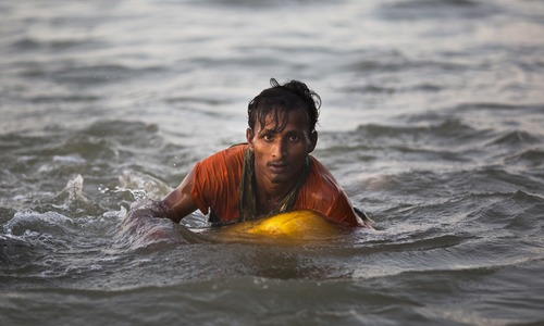 'I was so scared of dying': Desperate Rohingyas swim from Myanmar to Bangladesh to flee violence