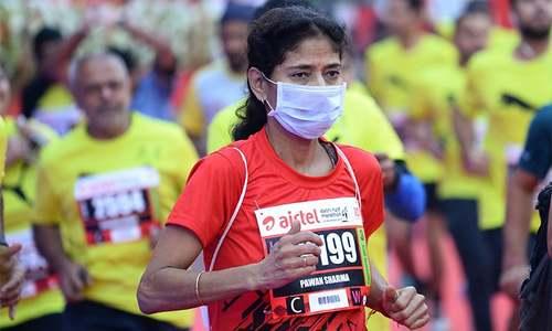 'My eyes are burning': Delhi half marathon goes ahead despite smog