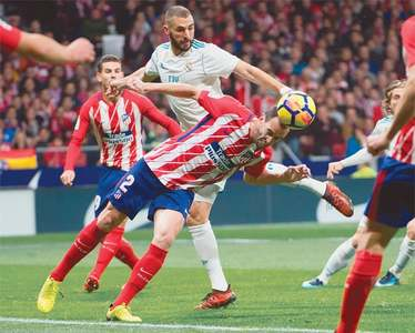 Suarez inspires Barca, Real and Atletico in derby stalemate
