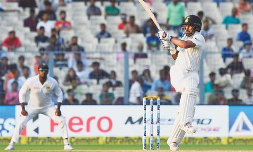India ride on  Rahul-Dhawan stand to surge ahead in Kolkata Test